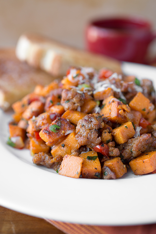 Autumn Sweet Potato Hash with Spicy Italian Sausage and Asiago Cheese