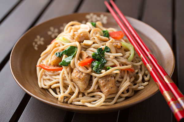 Saucy Peanut Chicken With Veggies Over Brown Rice Noodles, Deliciously Tangled Up