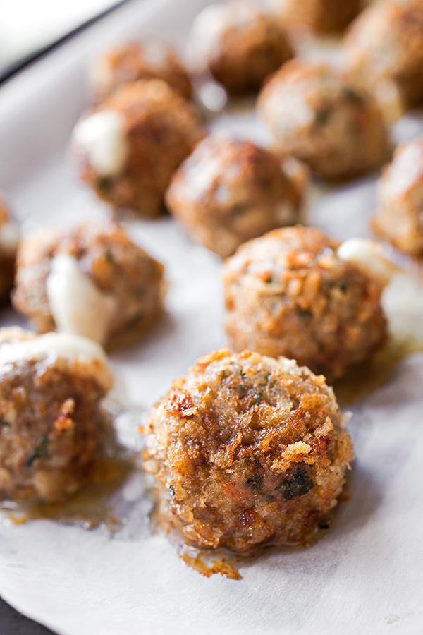 Mozzarella Stuffed Meatballs | thecozyapron.com