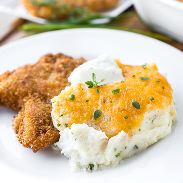 Roasted Garlic Mashed Potatoes with Broiled Cheddar | thecozyapron.com