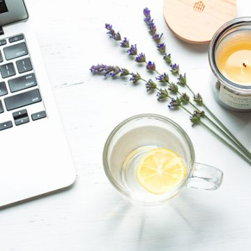 Morning ritual with lemon water and a candle