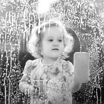 Little girl washing window | thecozyapron.com