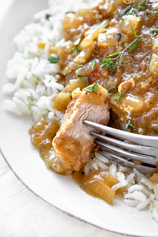 Smothered Pork Chops in a Savory Pan Sauce | thecozyapron.com