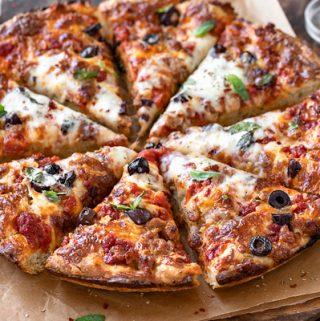 Cast Iron Pizza on Cutting Board | thecozyapron.com