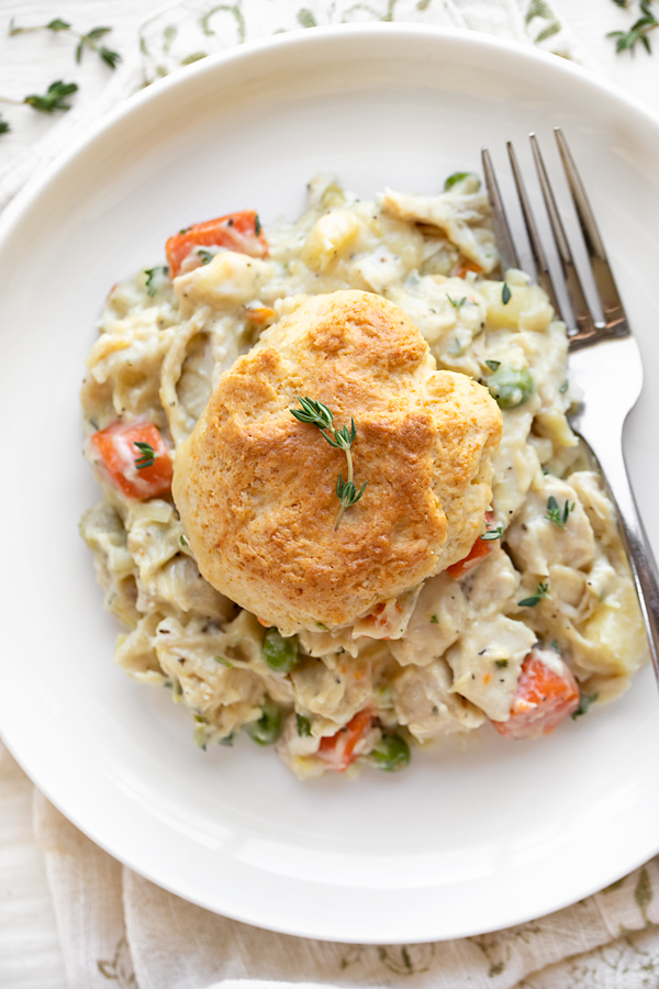 Chicken Pot Pie with Biscuits on a Plate | thecozyapron.com