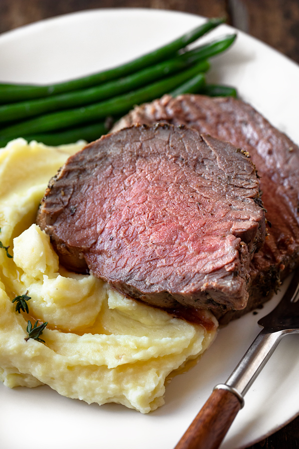 Beef Tenderloin with Herb-Pepper Crust with Mashed Potatoes | thecozyapron.com